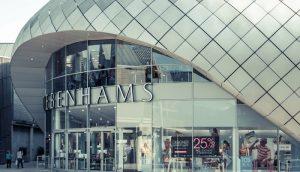 BURY ST EDMUNDS, UK – March, 2015: Shoppers walk past the Debenh